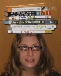 Alice balancing all the books that came in August 2008. Eep!
