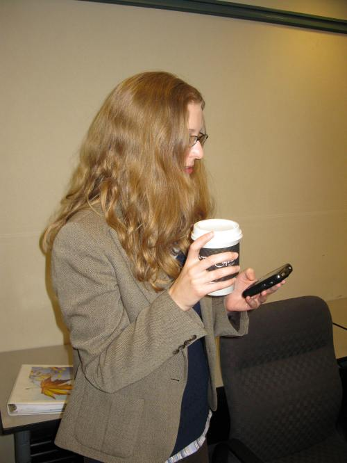 Will snaps a quick picture of me with two essential conference tools: coffee and Blackberry.