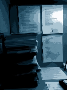 Picture of pile of manuscripts on Bob Nirkind's Desk